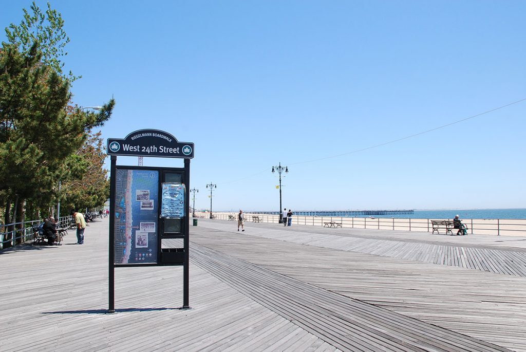 boardwalk view with sign and beach