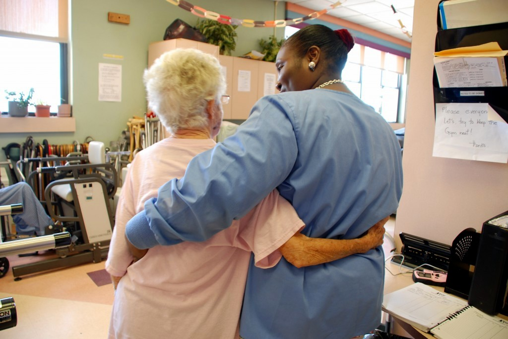 Patient and therapist hugging